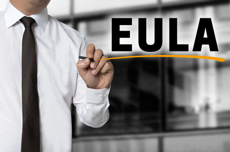 end user: Eula is written by businessman background concept. Stock Photo