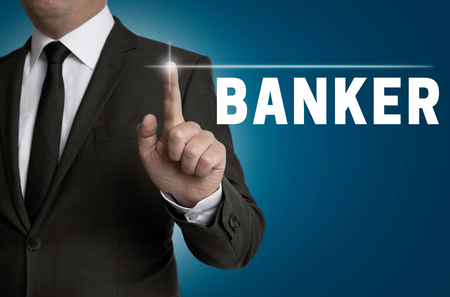 banker: banker touchscreen is operated by businessman concept.