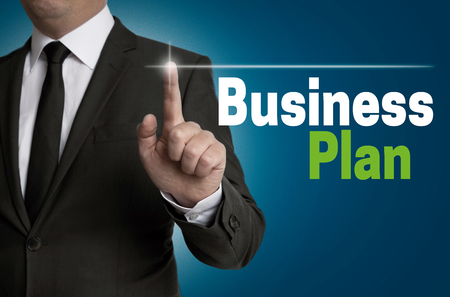 businessplan: Businessplan touchscreen is operated by businessman concept