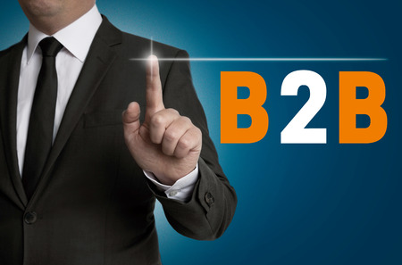 b2b: B2B touchscreen is operated by businessman concept.