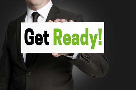 Get ready sign is held by businessman concept. Stock Photo
