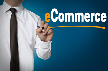 e commerce: e commerce is written by businessman background concept.