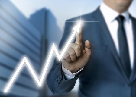 touchscreen: Man draws stock price touchscreen concept.