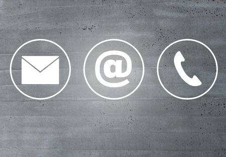 Contatto icone messaggio e-mail concetto di telefono cellulare. Archivio Fotografico