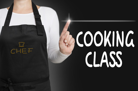 cooking class touchscreen is operated by chef.