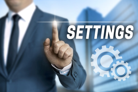 configure: settings touchscreen is operated by businessman. Stock Photo