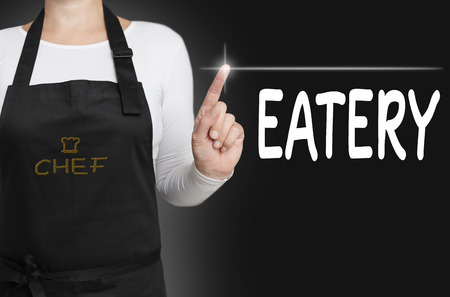 eatery touchscreen is operated by chef. Stock Photo