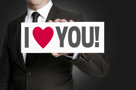 i love you sign: i love you sign held by businessman.
