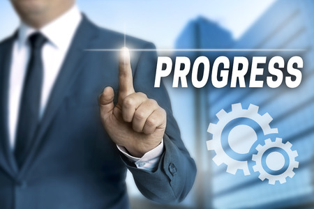 touchscreen: progress touchscreen is operated by businessman. Stock Photo
