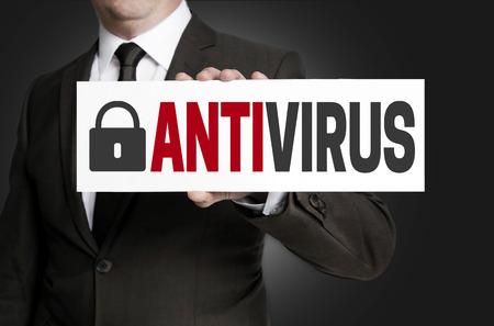 antivirus placard is held by businessman.