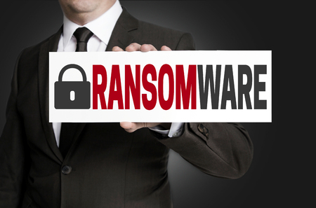 ransomware protection is held by businessman. Standard-Bild