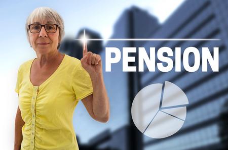 touchscreen: pension touchscreen is shown by Senior woman. Stock Photo