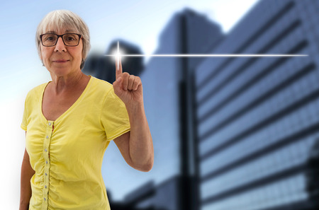shown: empty touchscreen is shown by senior. Stock Photo