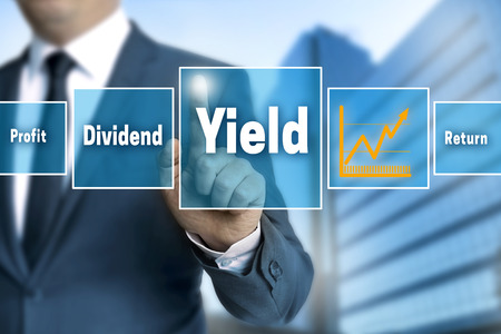 yield: yield touchscreen is operated by businessman.