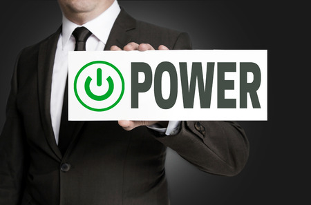 getting started: power sign is held by businessman.