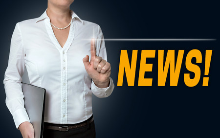 touchscreen: news touchscreen is operated by businesswoman.