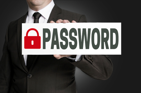 parole: password placard is held by businessman.