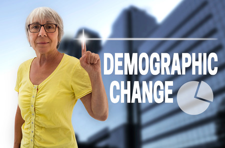 births: demographic change touchscreen is shown by senior. Stock Photo