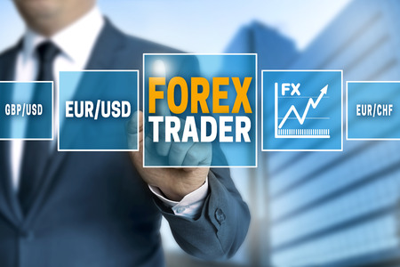 trader: Forex trader touchscreen is operated by businessman.