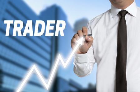 touchscreen: trader draws market price on touchscreen. Stock Photo