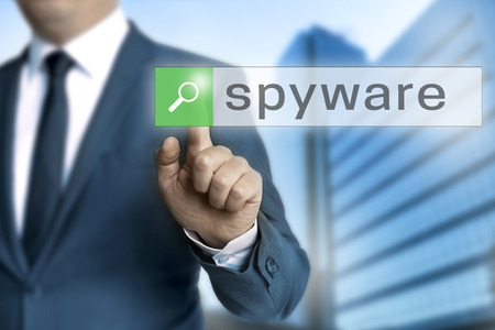 spy ware: spyware browser is operated by businessman background.