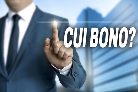 qui: cui bono touchscreen is operated by businessman.