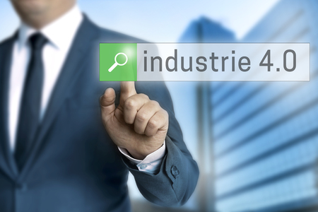 40: industry 4.0 in german industrie browser is operated by businessman Stock Photo