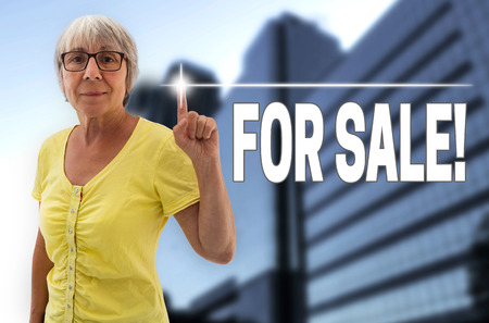 touchscreen: for sale touchscreen is shown by Senior Woman background. Stock Photo