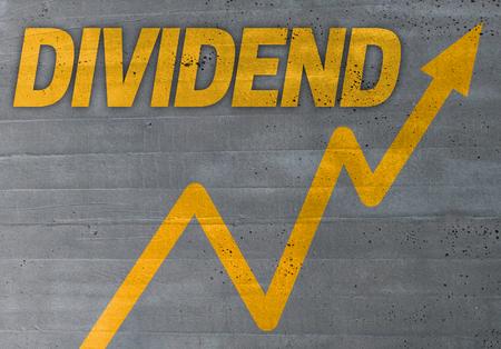 dividend: dividend graph concept on cement texture background.