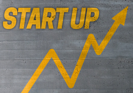 founding: start up graph concept on cement texture background.
