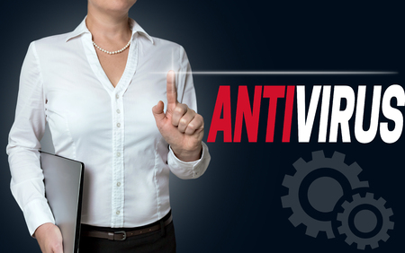 antivirus touchscreen is operated by businesswoman background.