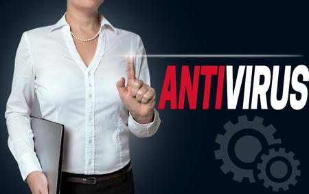 antivirus: antivirus touchscreen is operated by businesswoman background.
