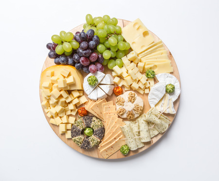 cheese plate: Cheese plate variation on white background. Stock Photo