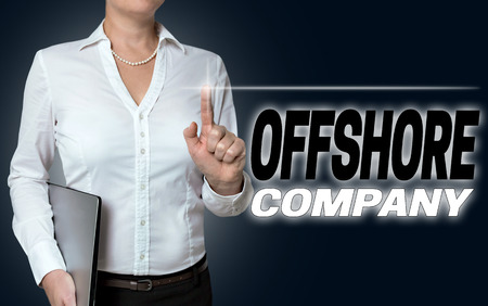 informant: offshore company touchscreen is operated by businesswoman background. Stock Photo