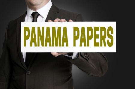 panama papers sign is held by businessman.
