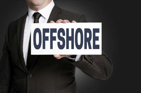 informant: offshore sign is held by businessman.