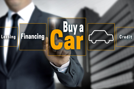 touchscreen: buy a car touchscreen is operated by businessman.