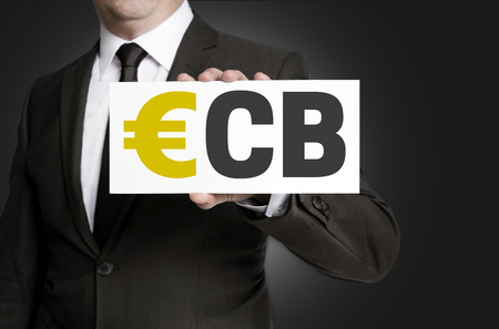 ecb: ecb sign is held by businessman background.
