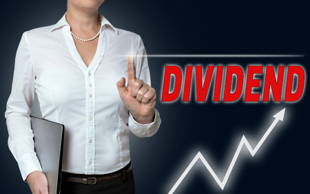 dividend: dividend touchscreen is operated by businesswoman background.