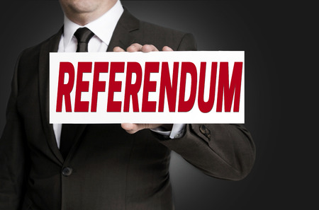 a placard: referendum placard is held by businessman. Stock Photo