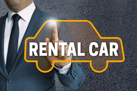 rental: rental car car touchscreen is operated by businessman concept.