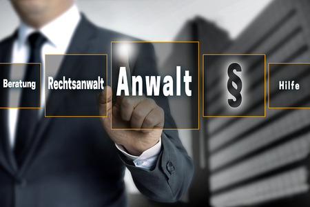 anwalt (in german lawyer, attorney, help, advice) touchscreen is operated by businessman.