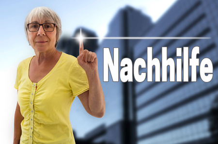 the elderly tutor: nachhilfe (in german tutoring) touchscreen is shown by senior.