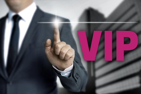 touchscreen: vip touchscreen is operated by businessman Stock Photo