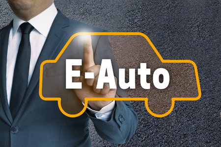 e auto touchscreen is operated by businessman concept.