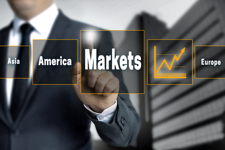 touchscreen: markets touchscreen is operated by businessman.