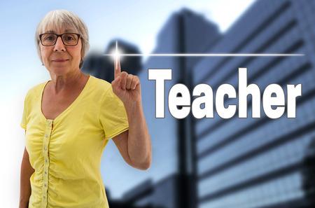 the elderly tutor: teacher touchscreen is shown by senior woman.