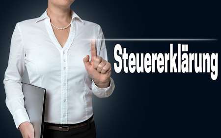 declaration: steuererklaerung (in german tax declaration) touchscreen is operated by businesswoman. Stock Photo