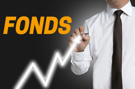 distinguishes: fonds (in german fund) trader distinguishes market price on touchscreen. Stock Photo