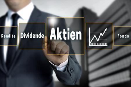 dividend: Aktien, Rendite, Dividende, Fonds (in german shares, dividend, return, fund) broker with touchscreen.
